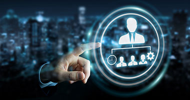 hand pointing to image on glass screen of company organization chart with leader at top