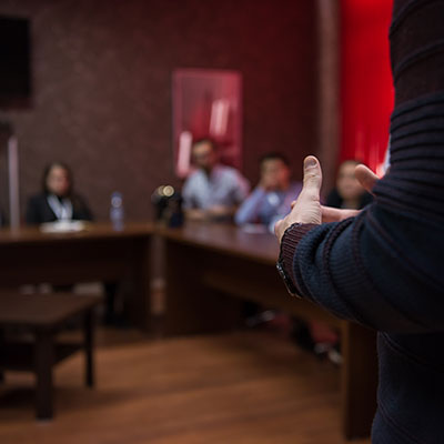 Business leader speaking to other leaders in conference room