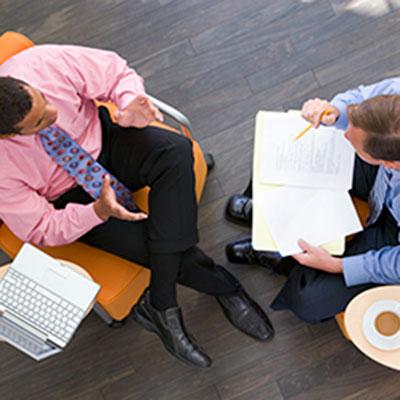 Business leader coaching an employee