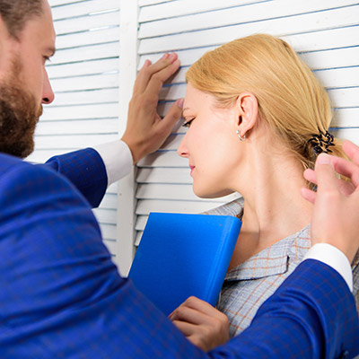 sexual harrassment - business woman being harrassed by male colleague