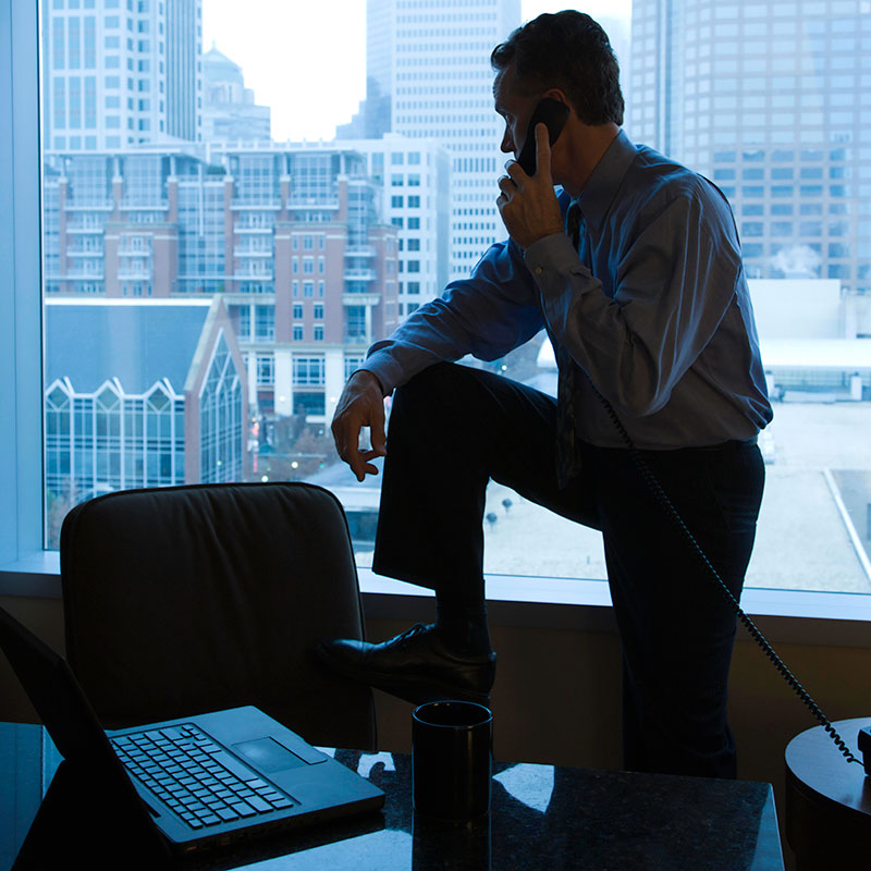 Business man participating in private phone consultation with Genesis Group counselor